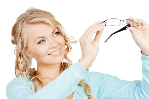 photo of a woman holding up a pair of glasses